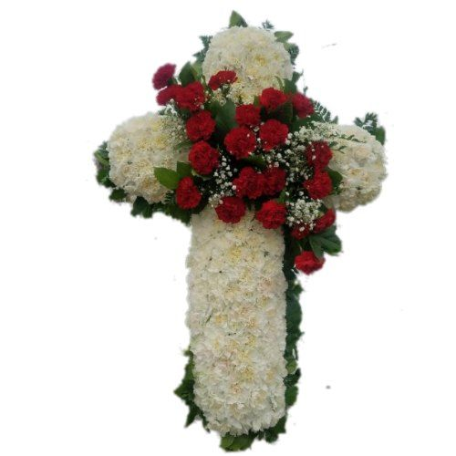 Sympathy white cross with red flowers on the center arrangement
