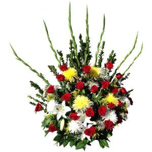 Special arrangement with pompon yellow and white and red roses and green plants