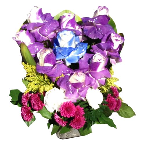 Purple roses heart with a blue rose and another flowers in a base
