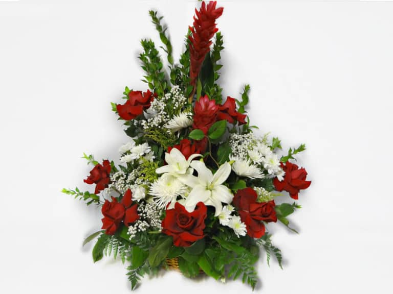 Bouquet in a basket with 8 Roses, 2 Gingers , 3 Spiders, 3 Pompon, Baby Breath, Lemon Leaves