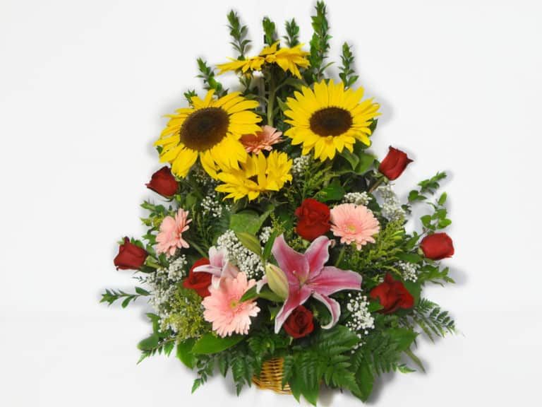 Bouquet in a basket with 8 Roses, 3 Sunflowers, 4 Gerberas Daisies, Baby Breath, Lemon Leaves.
