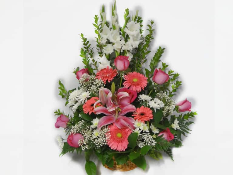 Bouquet in a basket with 8 Roses, 3 Gladiolus, 5 Gerberas, 4 Pompon, , Baby Breath, Lemon Leaves.