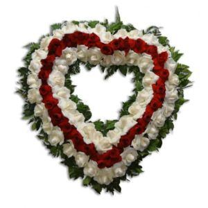 Sympathy heart shape floral arrangement with red and white roses
