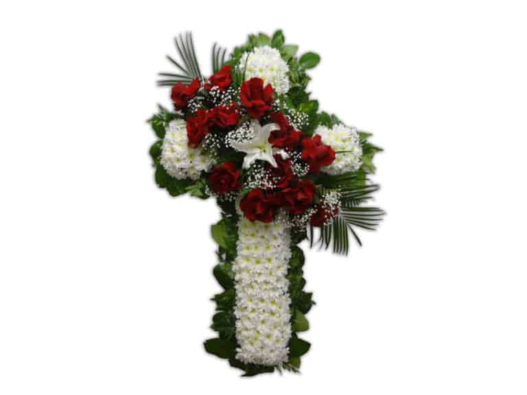 White Sympathy Flowers cross arrangement with 12 Roses 1 Lily 1 Pom Pom