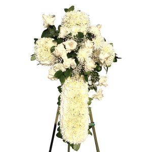 White cross made with white flowers, sympathy flowers