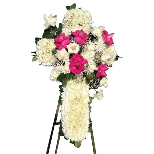 Sympathy floral arrangement white cross with pink and white roses on the center