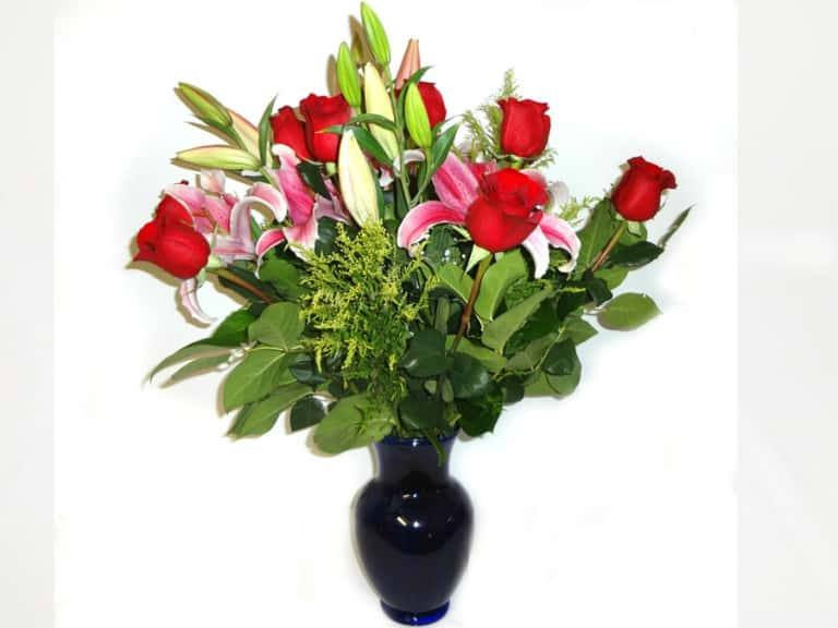 Flowers in a vessel with 12 Roses, 3 Lilies.