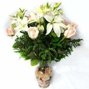 Flowers in a vessel with 6 Roses, 4 Lilies.