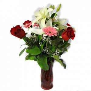 Flower in a vessel with 7 Roses, 6 Gerberas, 2 Lilies.