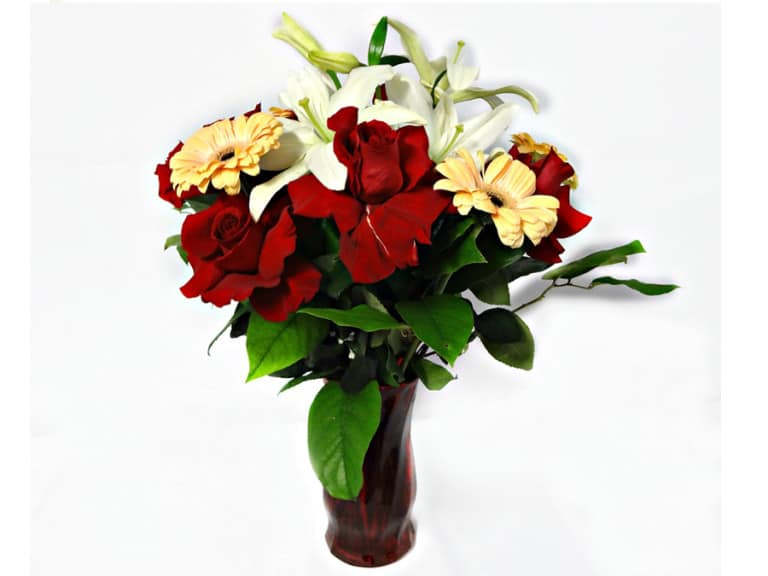 Flower in a vessel with 7 Roses, 4 Gerberas, 2 Lilies