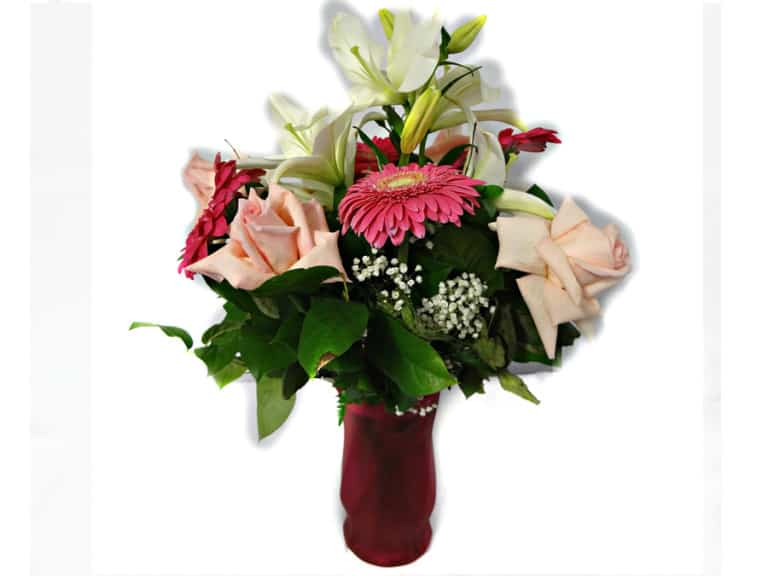 Flower in a vessel with 4 Pink Roses, 1 Lily, 4 Gerberas.