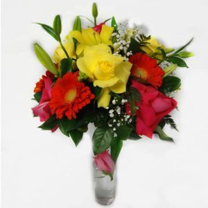 Flower in a vessel with 4 Pink Roses, 3 Yellow Roses, 2 Lilies, 4 Gerberas