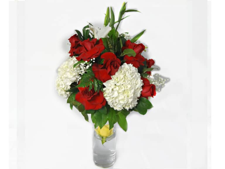 Bouquet in a vessel with 12 Roses, 4 Flowers, 1 Lily.