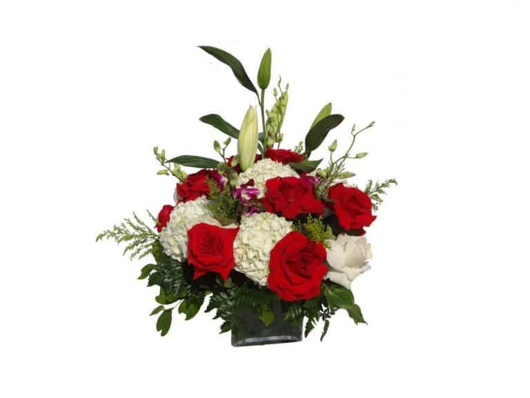 Vase bouquet with 24 Roses, 4 Orchids, 7 Flowers, 3 Lilies, Solidago, Lemon Leaves.