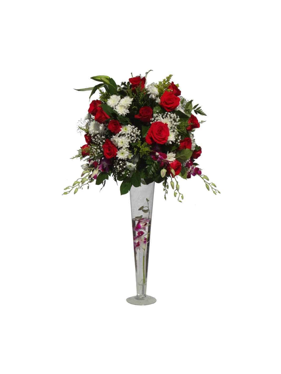 Long vessel bouquet with 8 Orchids, 26 Roses, 12 Daisies, Baby bread, Lemon leaves.