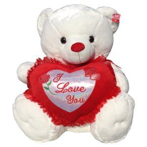 White teddy bear with a heart that said I Love You