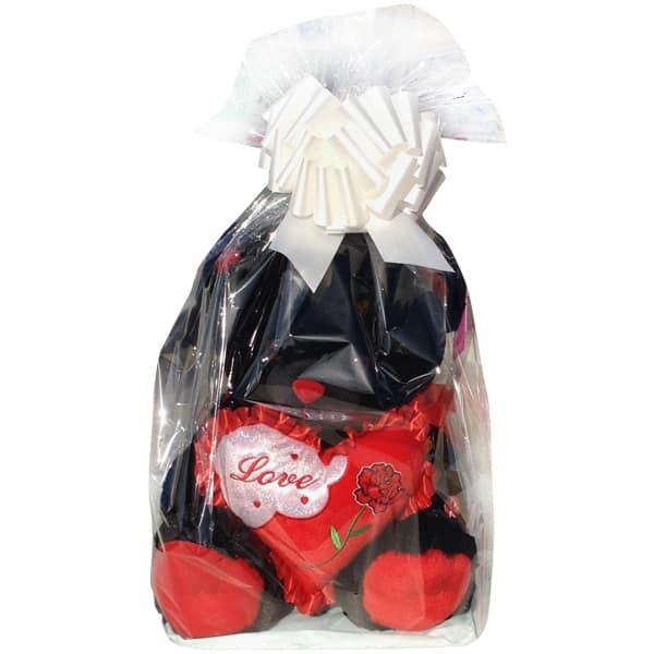 Black teddy bear with a heart that said Love