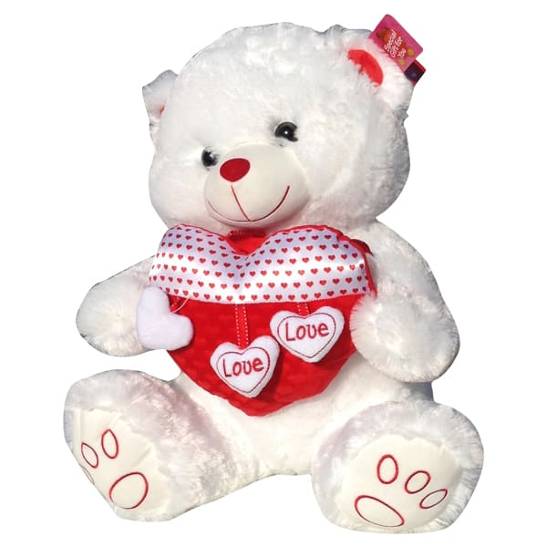 White teddy bear with a heart that said love love