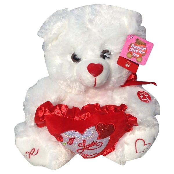 White purple teddy bear with a heart that said Love You