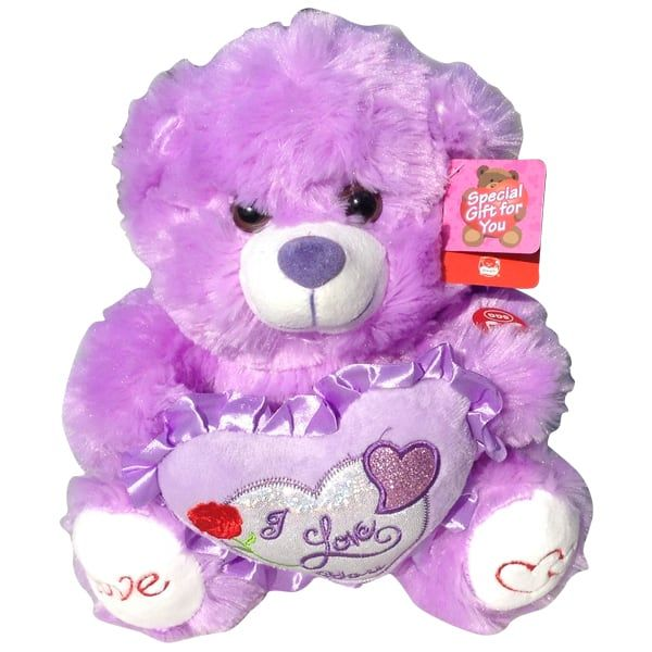 Light purple teddy bear with a heart that said Love You