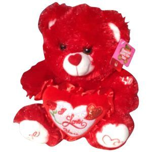 Red teddy bear with a heart that said Happy Birthday