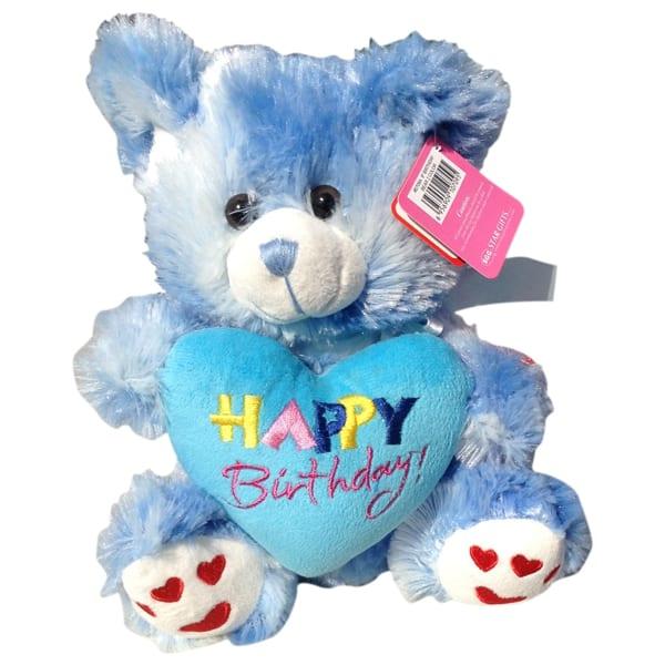 Blue teddy bear with a heart that said Happy Birthday