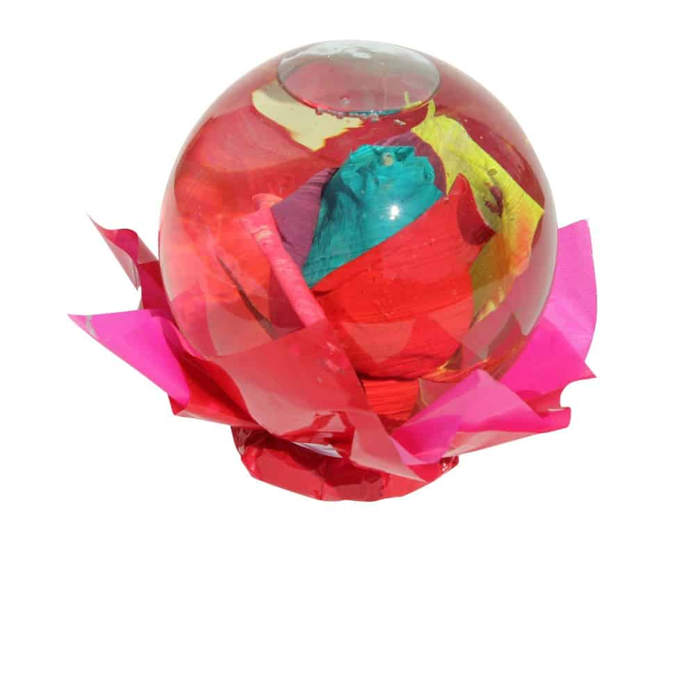 Multicolor rose inside a spheric bubble of glass filled out with water
