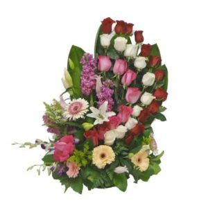 Basket bouquet with 25 Roses, 3 Lilies, 2 Orchids, 4 Gerberas, 3 Stalks and Tilips
