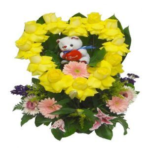 Yellow Heart with teddy bear inside with 13 Roses, 3 Lilies, 5 Gerberas, 2 Stalks and 1 Teddy Bear