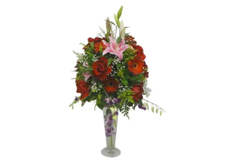 Long elegant vessel bouquet with 12 Roses, 8 Gerberas, 5 Orchids, 3 Lilies