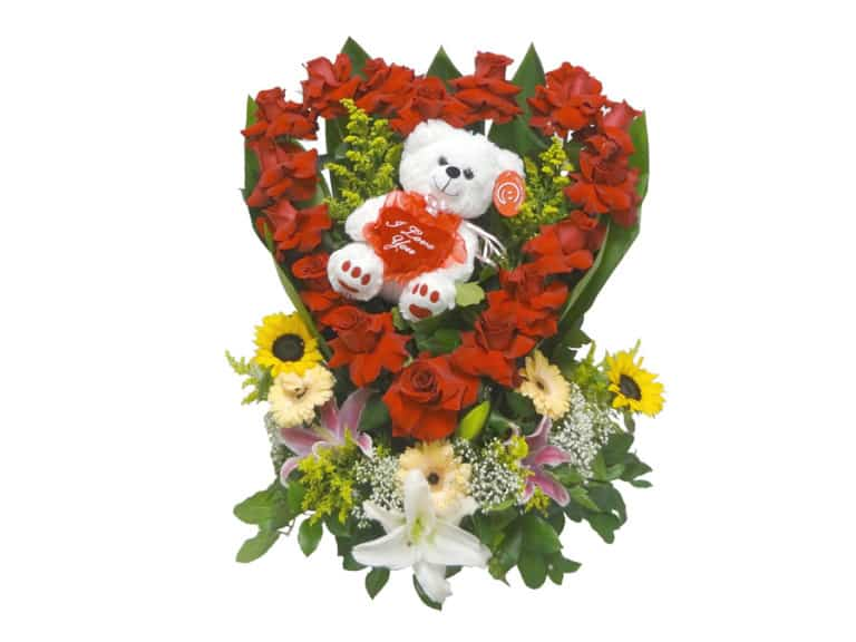 Teddy bear inside of a heart of red roses with 18 Roses, 2 Sunflowers, 3 Gerberas, 3 Lilies, 1 Teddy Bear
